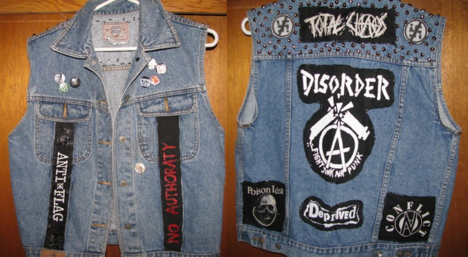 Punk Jacket Covered in Patches. Anarchist symbol, Squatters Rights Symbol, Anti-Racist Symbol, No Authority.